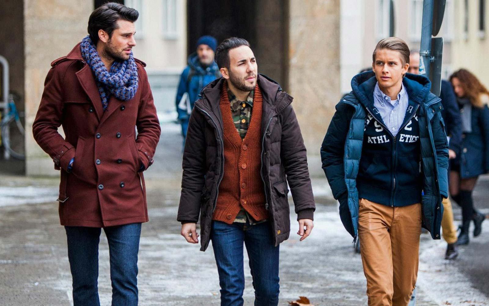 Men wearing various winter jackets