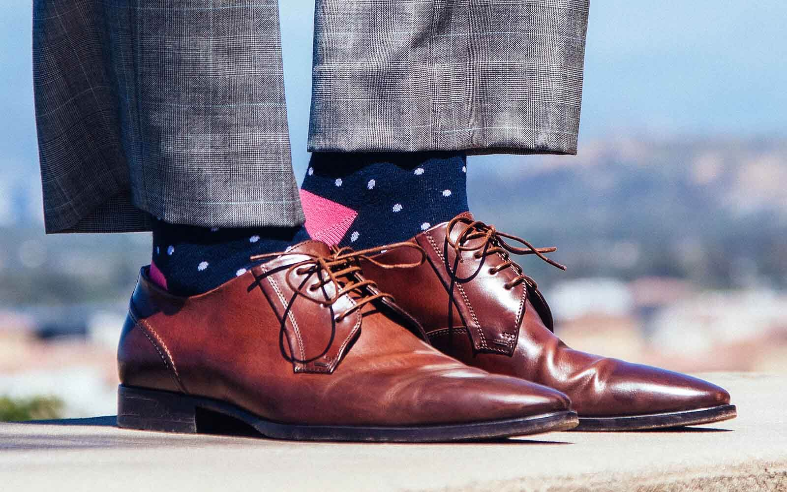 man wearing slacks with ties.com socks
