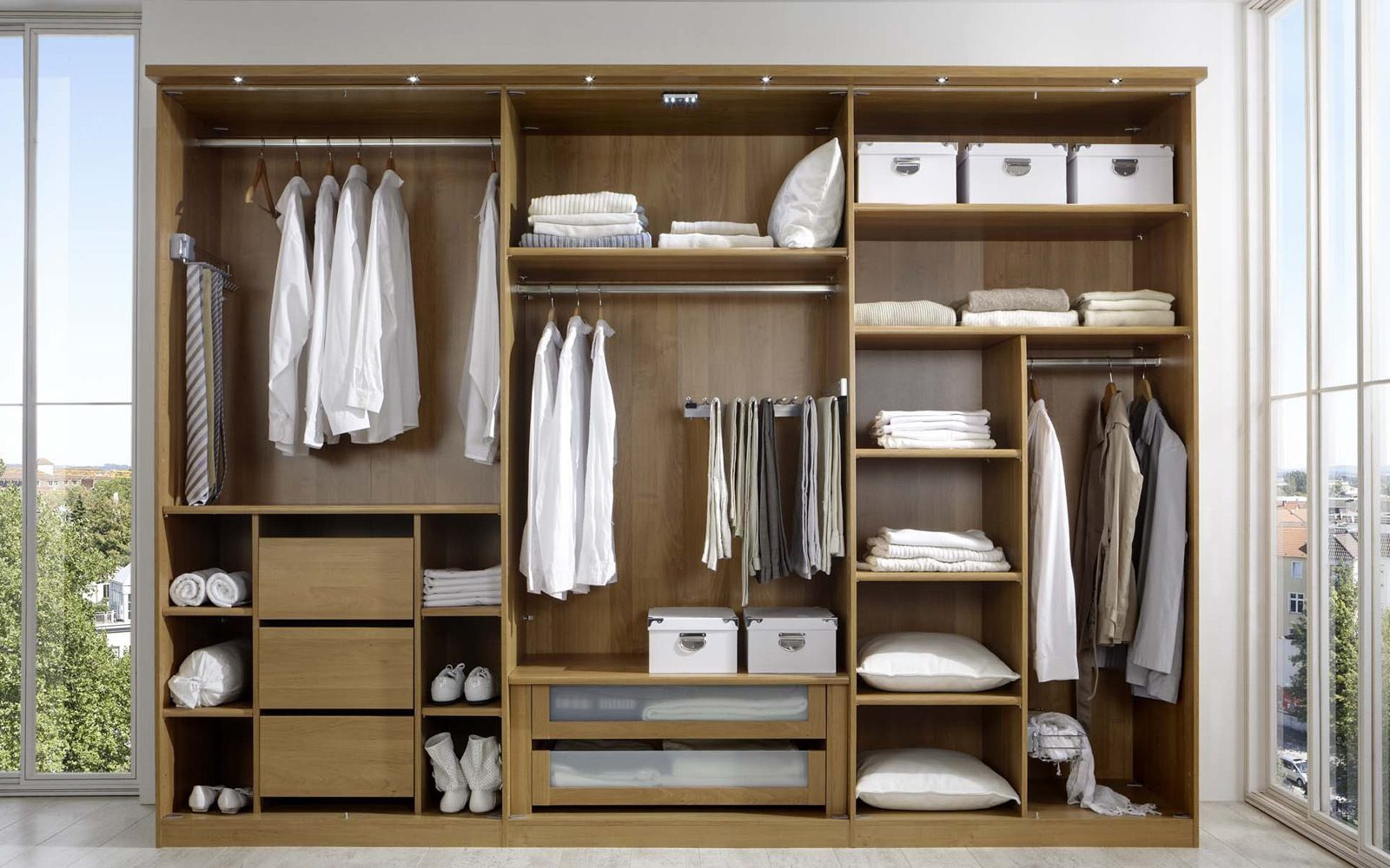 Organized closet with white clothes