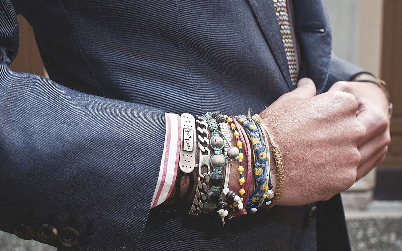 Man wearing varying bracelets