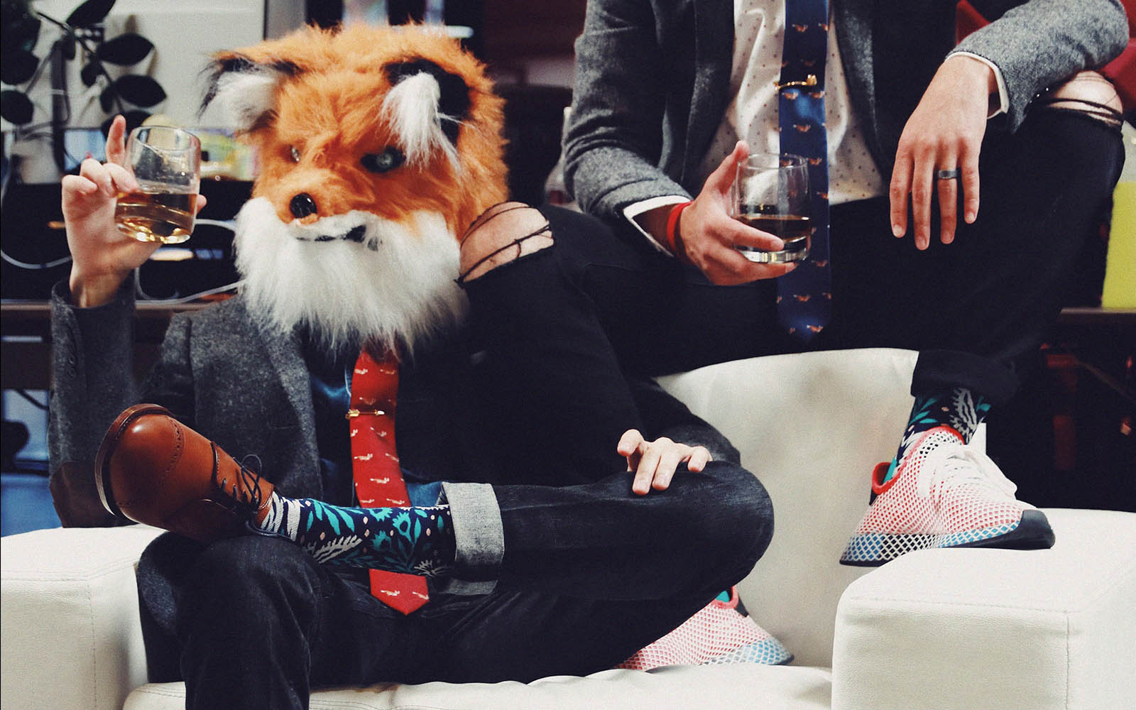 man in suit wearing fox mask