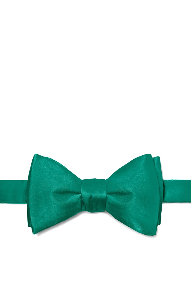 Hunter Green Self-Tie Bow Tie by Elite Solid -  Hunter green Silk The secret to dressing well is found in the little things the details. And one of the most important details for a man is the bowtie. Crisp and refined a well cared for bowtie knotted firmly about your neck is the mark of a man of sophistication. And it is this sort of sophistication found bustling within this all-silk men's bowtie. Rendered in a rich hunter green this elegant bowtie will get you noticed without distracting from your overall appearance. After all that's what good clothing should do. Imported.