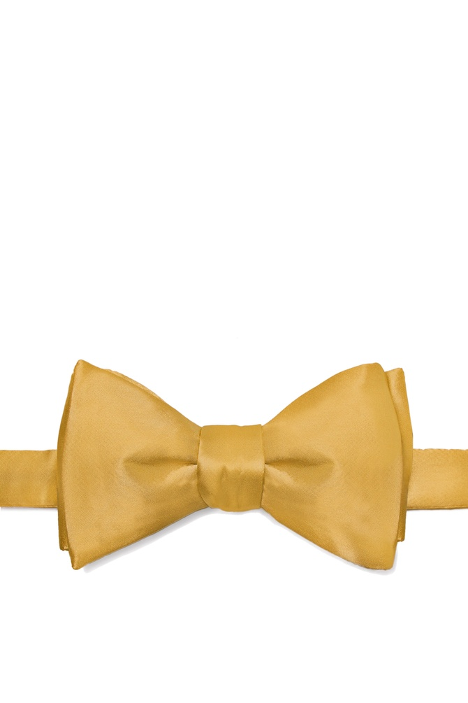 Bright Gold Self-Tie Bow Tie by Elite Solid -  Bright gold Silk The secret to dressing well is found in the little things the details. And one of the most important details for a man is the bowtie. Crisp and refined a well cared for bowtie knotted firmly about your neck is the mark of a man of sophistication. And it is this sort of sophistication found bustling within this all-silk men's bowtie. Rendered in a rich gold hue this elegant bowtie will get you noticed without distracting from your overall appearance. After all that's what good clothing should do. Imported.